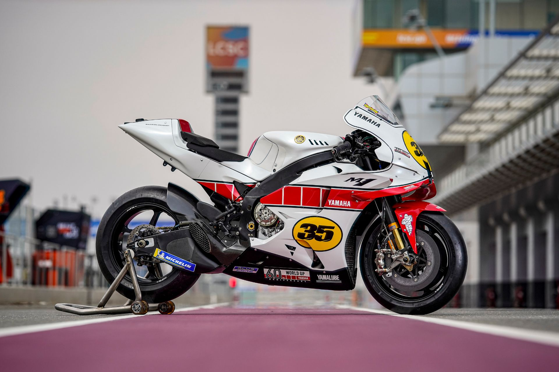 Cal Crutchlow Celebrating 60 Years of Grand Prix Racing with YZR M1 in Traditional Yamaha WhiteRed Livery (1)